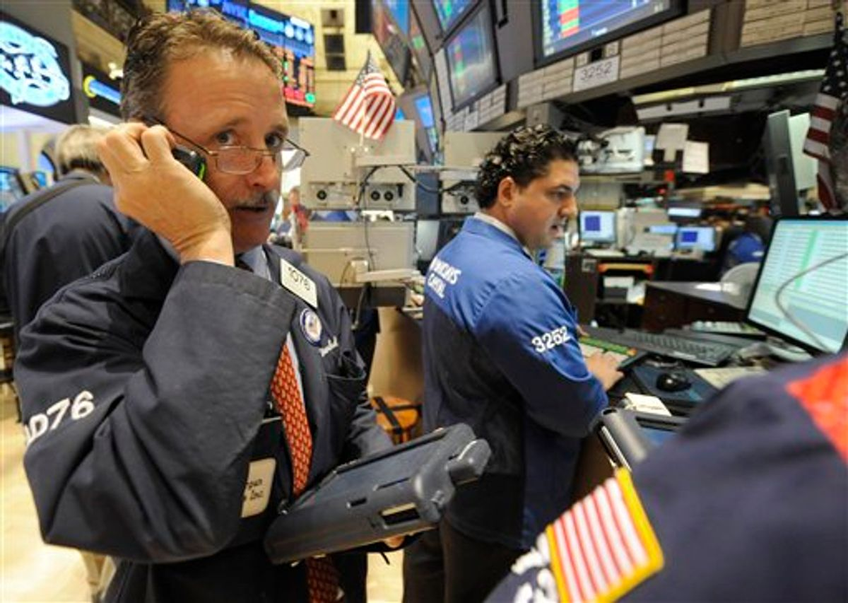 FILE - In this file photo taken May 6, 2011, traders work on the floor of the New York Stock Exchange, in New York. World share markets sank Thursday, May 12, 2011, after a slide on Wall Street sparked by tumbling demand for oil and fears of slackening growth in the U.S.(AP Photo/Henny Ray Abrams, file) (AP)