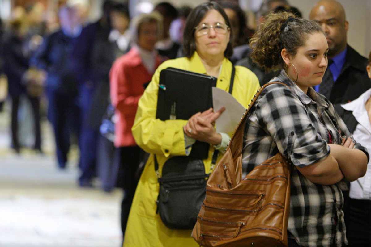 Job seekers wait in line for a job fair to open in Independence, Ohio, on May 3.