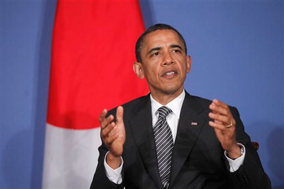 President Barack Obama speaks to reporters as he meets with Japan's Prime Minister Naoto Kan at the G8 summit in Deauville, France, Thursday, May 26, 2011. (AP Photo/Charles Dharapak) (AP)