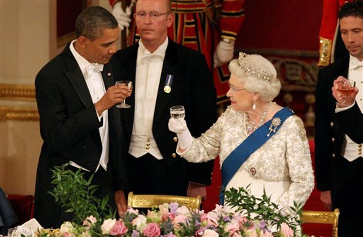 Britain's Queen Elizabeth II, and U.S. President Barack Obama during a state banquet in Buckingham Palace, London, on Tuesday May 24, 2011. President Barack Obama immersed himself in the grandeur of Britain's royal family Tuesday, as Queen Elizabeth II welcomed him to Buckingham Palace for the first day of a state visit. (AP Photo/Lewis Whyld, Pool) (AP)