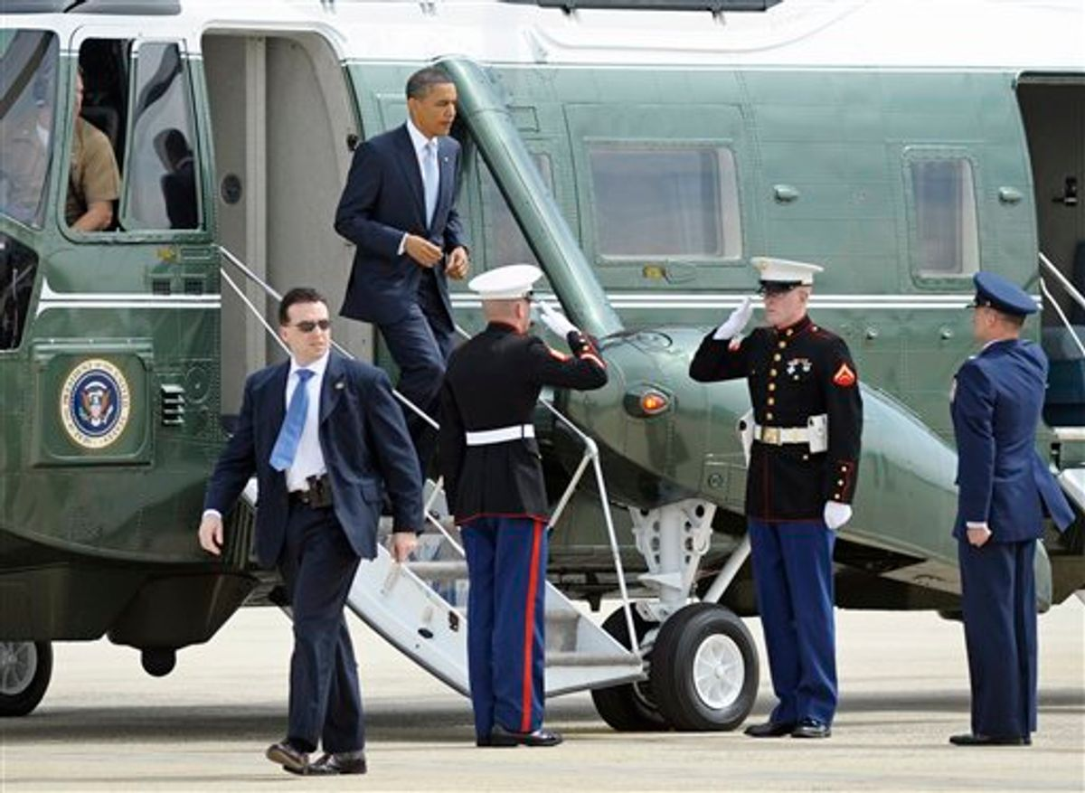 President Barack Obama exits Marine One at Andrews Air Force Base, Md., Tuesday, May 10, 2011, before boarding Air Force One to travel to Texas. (AP Photo/Cliff Owen) (AP)