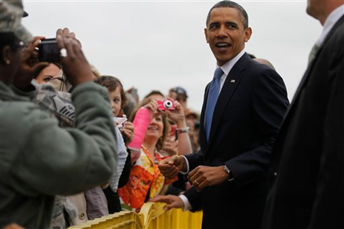 President Barack Obama greets well wishers upon arrival in Memphis, Tenn., Monday, May 16, 2011, where he will meet privately with families affected by flooding, and deliver the commencement address at Booker T. Washington High School. (AP Photo/Charles Dharapak) (AP)