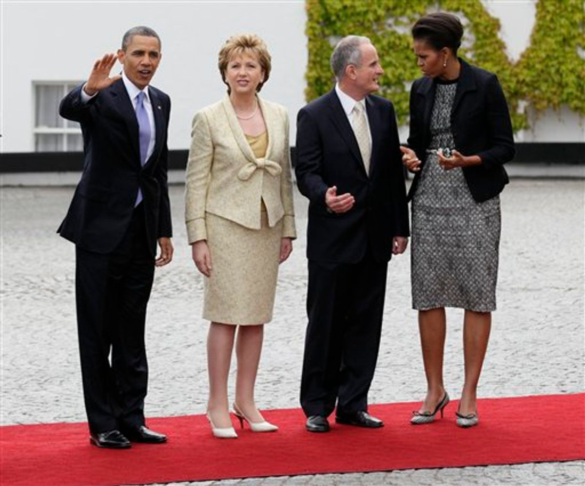 From left, President Barack Obama, President of Ireland Mary McAleese and her husband Martin McAleese, and first lady Michelle Obama stop to be photographed as President Barack Obama arrives at the Presidential Residence in Dublin, Ireland, Monday, May 23, 2011. President Barack Obama opens a six-day European tour with a quick dash through Ireland, where he will celebrate his own Irish roots and look to give a boost to a nation grappling with the fallout from its financial collapse.(AP Photo/Carolyn Kaster)  (AP)