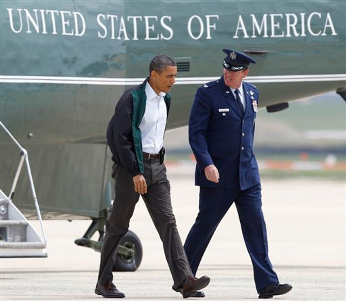 President Barack Obama walks with Col. Lee dePalo, Vice Commander of the 11th Wing, towards Air Force One at Andrews Air Force Base, Md., Sunday, May 29, 2011, on his way to visit tornado victims in Joplin, Mo. (AP Photo/Luis M. Alvarez) (AP)