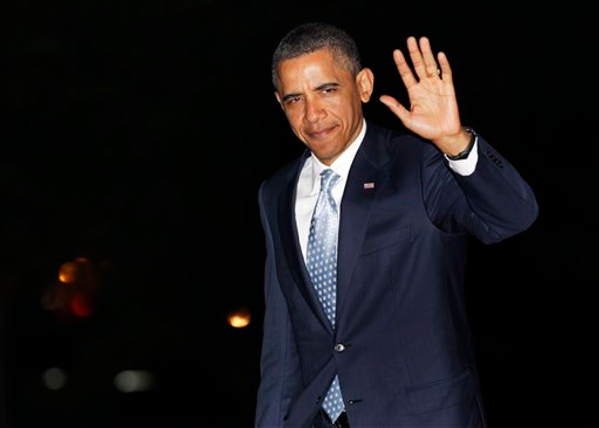 President Barack Obama waves to media as he walks from Marine One to the White House, Wednesday, May 11, 2011, in Washington, as he travels from Texas. (AP Photo/Carolyn Kaster) (AP)