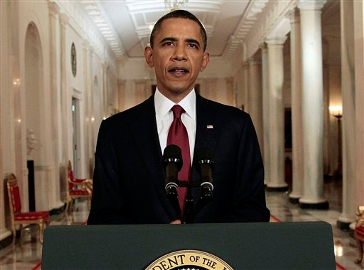 President Barack Obama reads his statement to photographers after making a televised statement on the death of Osama bin Laden from the East Room of the White House in Washington, Sunday, May 1, 2011.  (AP Photo/Pablo Martinez Monsivais) (AP)