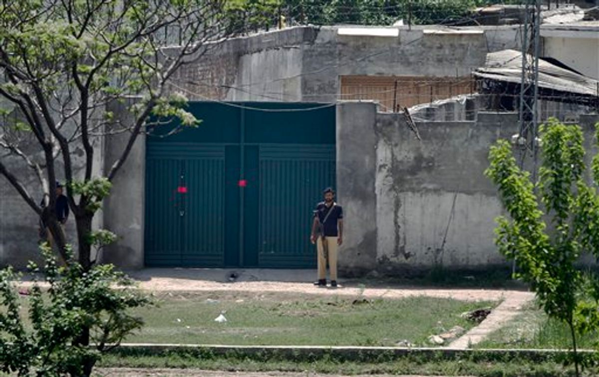 Pakistani police officers stand guard at the main gate of a house where al-Qaida leader Osama bin Laden was caught and killed in Abbottabad, Pakistan on Wednesday, May 4, 2011. The residents of Abbottabad, Pakistan, were still confused and suspicious on Wednesday about the killing of Osama bin Laden, which took place in their midst before dawn on Monday. (AP Photo/Anjum Naveed) (AP)