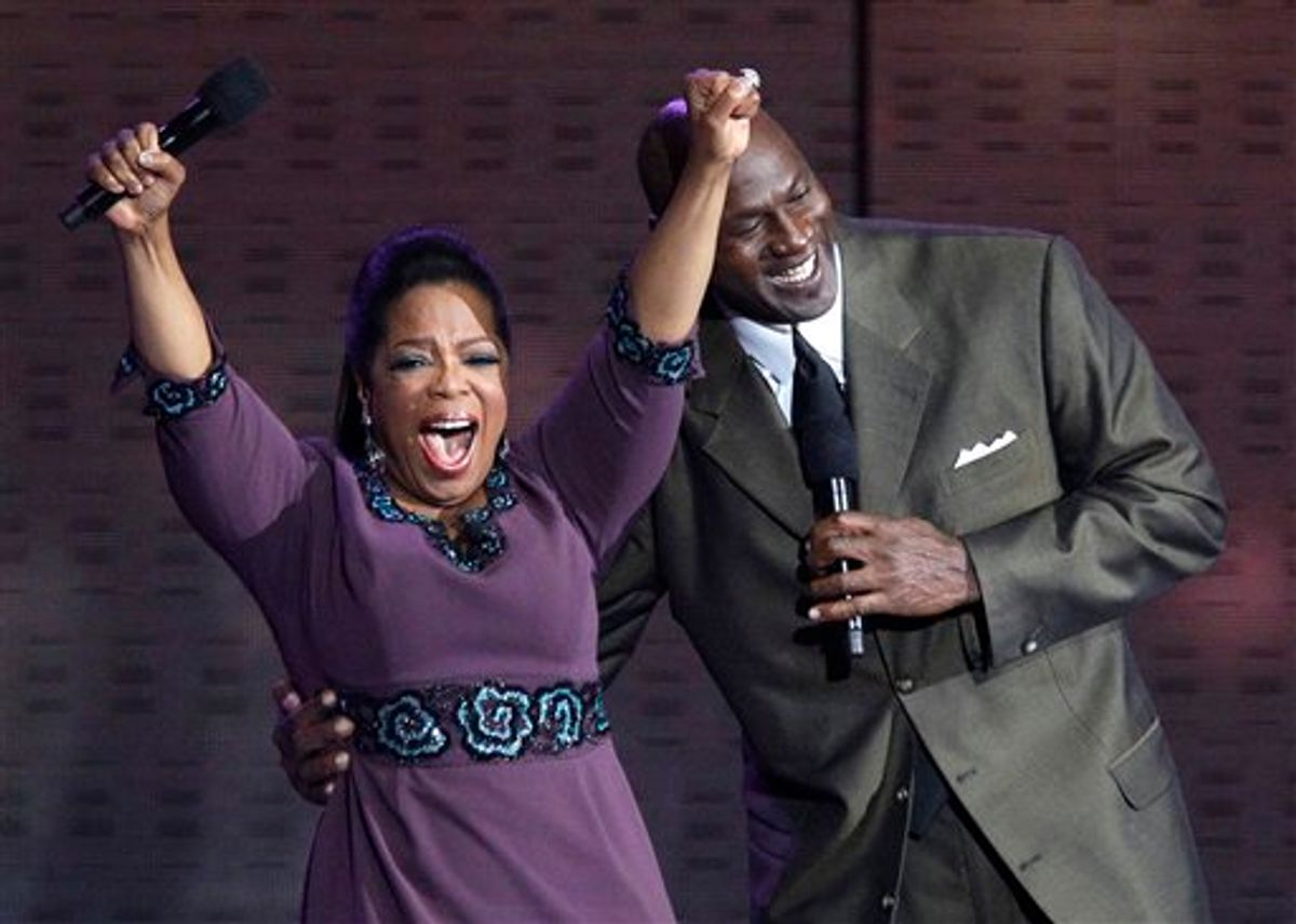 """Oprah Winfrey reacts as Michael Jordan appears during a star-studded double-taping of """"Surprise Oprah! A Farewell Spectacular,"""" Tuesday, May 17, 2011, in Chicago. """"The Oprah Winfrey Show"""" is ending its run May 25, after 25 years, and millions of her fans around the globe are waiting to see how she will close out a show that spawned a media empire. (AP Photo/Charles Rex Arbogast)   (AP)"""