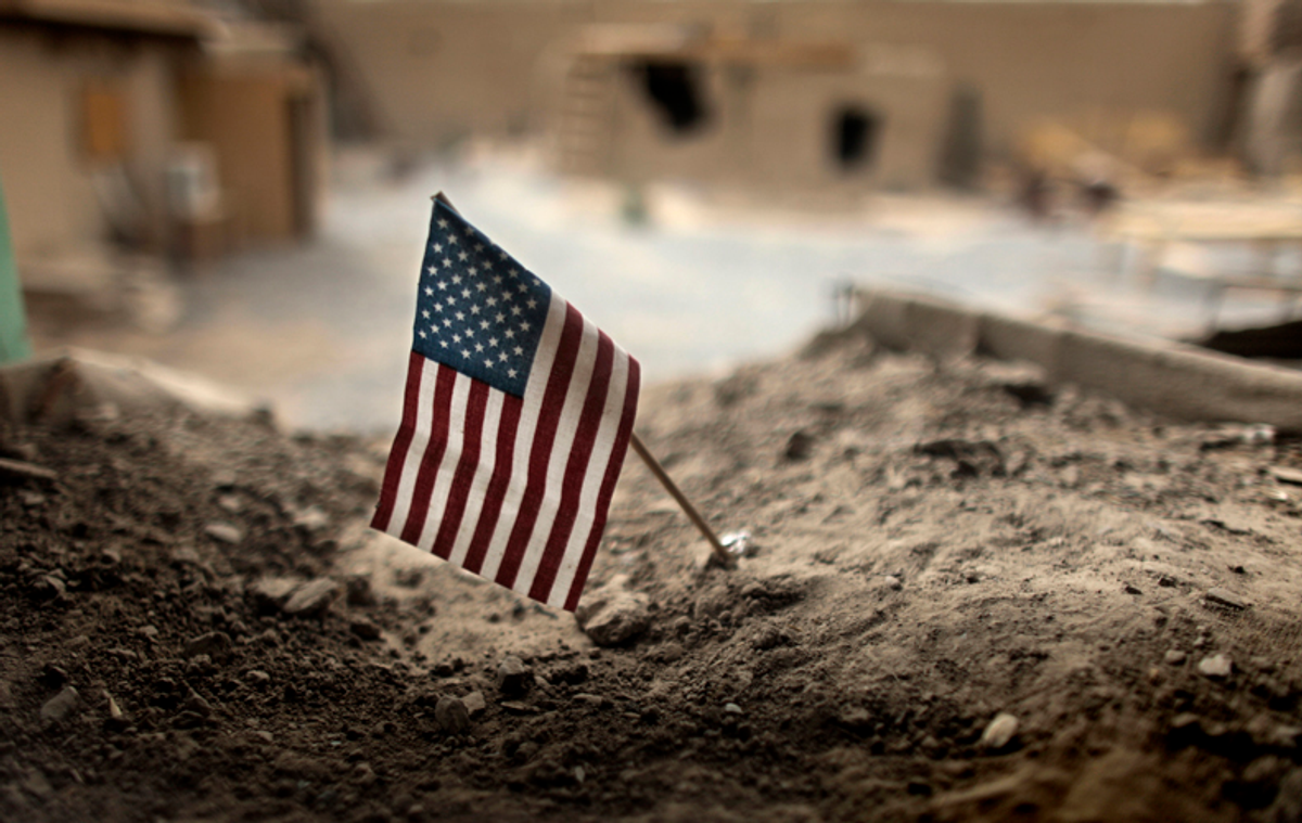 An American flag is placed in a dirt-filled barrier outside the headquarters of 3rd Platoon, 1-320 Field Artillery Regiment, 101st Airborne Divivion, at Combat Outpost Nolen in the Arghandab Valley north of Kandahar July 22, 2010.