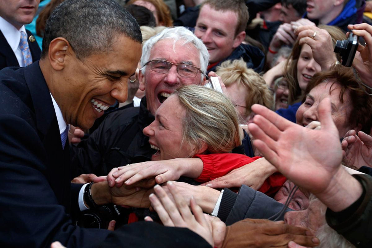 President Obama smiles as he shakes hands with a crowd of local residents in Moneygall.