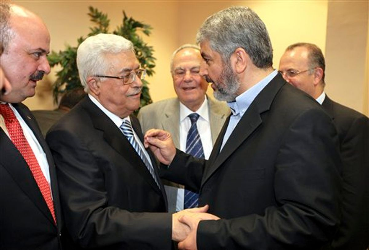 In this photo released by the Hamas Media Office, Palestinian President Mahmoud Abbas, center-left, and Hamas leader Khaled Mashaal, center-right, shake hands at a ceremony in Cairo, Egypt Wednesday, May 4, 2011. Rival Palestinian factions Fatah and Hamas on Wednesday proclaimed a landmark, Egyptian-mediated reconciliation pact aimed at ending their bitter four-year rift, at a declaration ceremony in the Egyptian capital Cairo. (AP Photo/Hamas Media Office) ** EDITORIAL USE ONLY, NO SALES **  (AP)