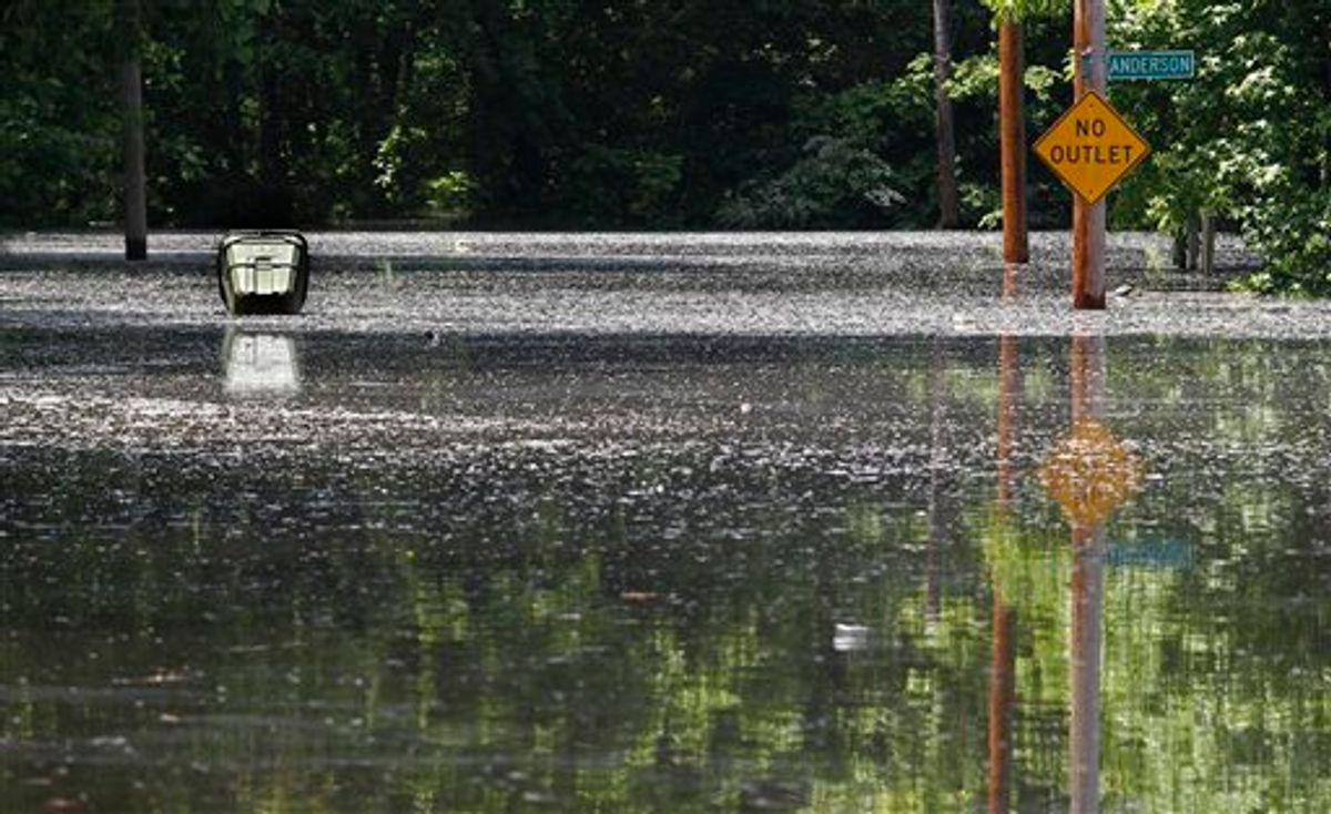 High water cover the road in the Box Town neighborhood as a waste can floats Sunday, May 8, 2011 in Memphis, Tenn. as flood waters continue to rise along the Mississippi River. (AP Photo/Wade Payne) (AP)
