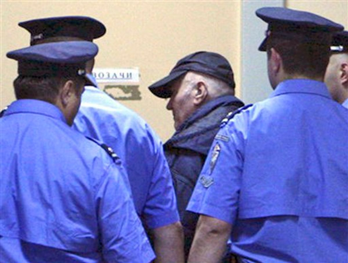 """In this handout image released by the Serbian government Thursday, May 26, 2011,  Ratko Mladic  enters court in Belgrade, Thursday, May 26, 2011.  Ratko Mladic, in baseball cap,  the ruthless Bosnian Serb military leader charged with orchestrating Europe's worst massacre of civilians since World War II, was arrested before dawn at a relative's home in a tiny Serbian village on Thursday after a 16-year hunt for the architect of what a war-crimes judge called """"scenes from hell.""""  (AP Photo / Serbian Government, HANDOUT) (AP)"""
