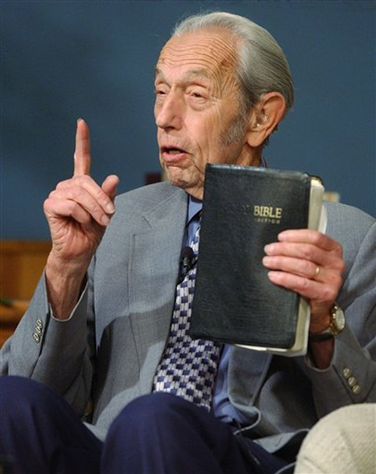 FILE - In this Dec. 12, 2002 file photo, Harold Camping speaks while holding the Bible, in San Leandro, Calif. A loosely organized Christian movement has spread the word around the globe that Jesus Christ will return to earth on Saturday, May 21, 2011, to gather the faithful into heaven. While the Christian mainstream isn't buying it, many other skeptics are believing it. The prediction originates with Camping, the 89-year-old retired civil engineer, who founded Family Radio Worldwide, an independent ministry that has broadcasted his prediction around the world. (AP Photo, File) (AP)