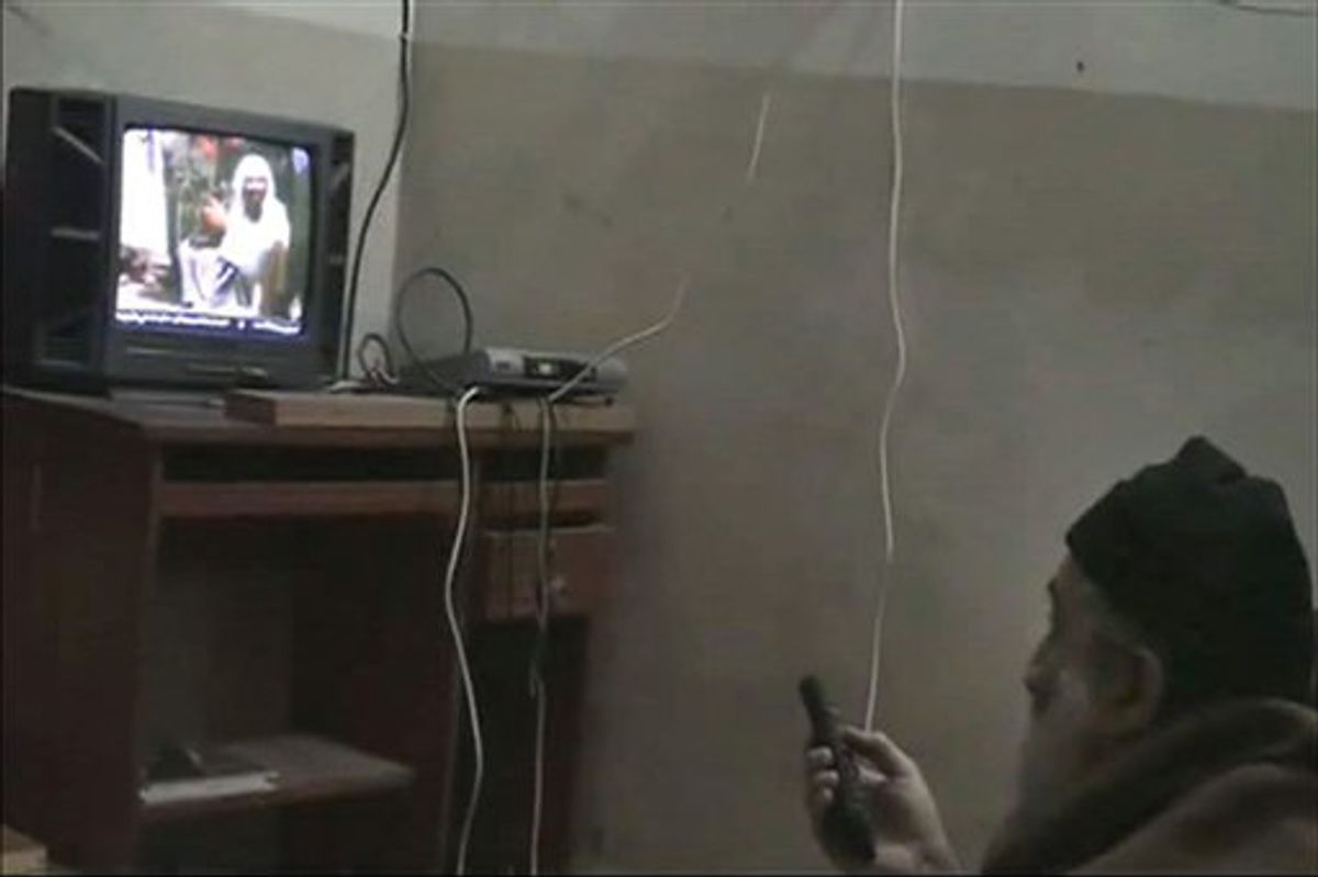 In this undated image from video seized from the walled compound of al-Qaida leader Osama bin Laden in Abbottabad, Pakistan, and released Saturday, May 7, 2011, by the U.S. Department of Defense a man, who the American government identified as Osama bin Laden, watches himself on television. U.S. intelligence would not confirm Saturday that the video of bin Laden in the makeshift office was filmed at the Pakistani compound, but they have said they believe he has been holed up in the compound for as long as six years. This and other videos released Saturday show him watching television and rehearsing for terrorist videos. (AP Photo/Department of Defense) (AP)