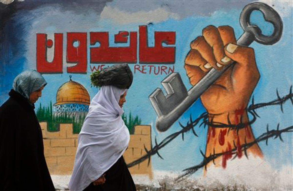 Palestinians walk past a painted wall during a rally marking the upcoming 63rd anniversary of the Nakba, or catastrophe, the Arabic term used to describe the uprooting of hundreds of thousands of Palestinians with the 1948 creation of the state of Israel, in Rafah refugee camp, southern Gaza Strip, Saturday, May 14, 2011.  Graffiti painting symbolically depicts the loss of the homes of Palestinians in 1948. ( AP Photo/ Eyad Baba ) (AP)