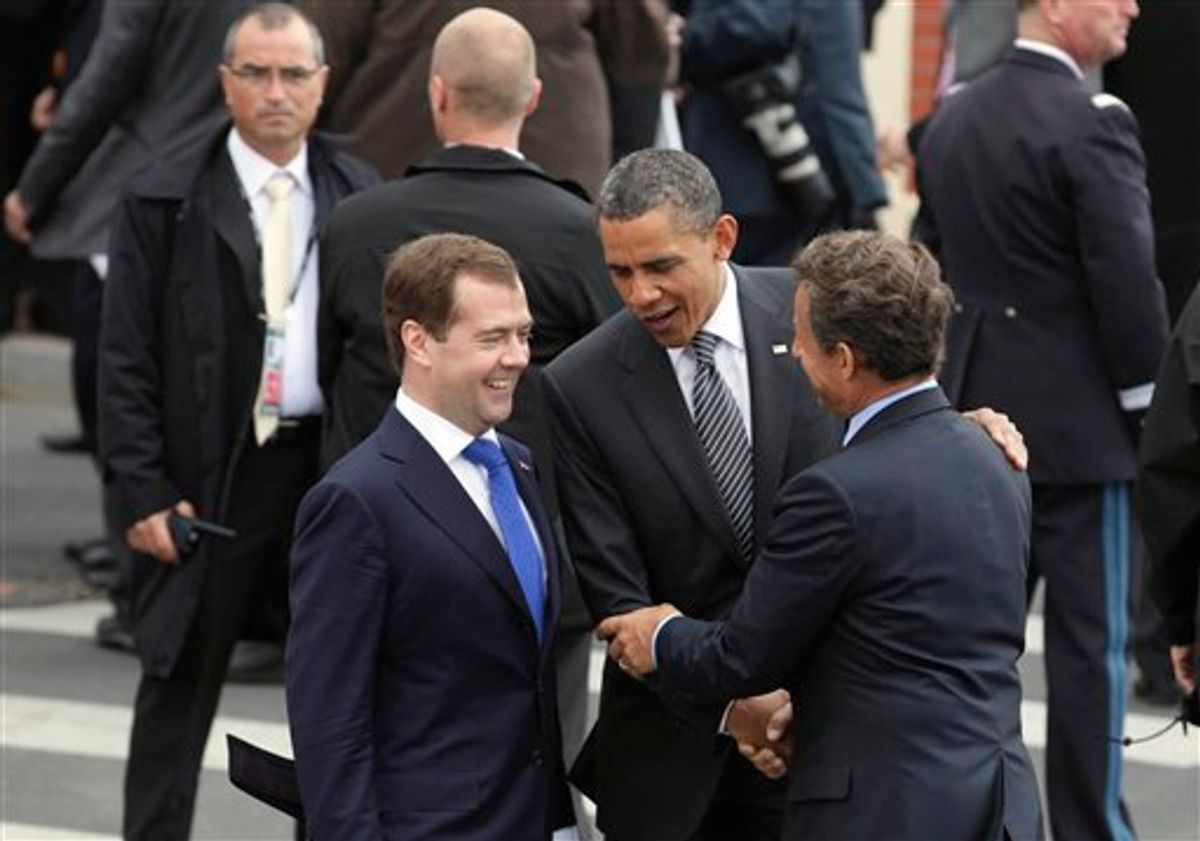 Russian President Federation Dmitry Medvedev, left, and President Barack Obama are greeted by French President Nicolas Sarkozy as they arrive at the G8 Summit, in Deauville, France, Thursday, May 26, 2011. (AP Photo/Carolyn Kaster)  (AP)