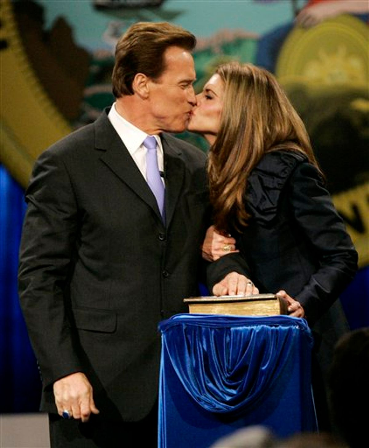 FILE - In this file photo taken Friday, Jan. 5, 2007, California Gov. Arnold Schwarzenegger kisses his wife, Maria Shriver, after taking his oath of office in Sacramento, Calif, .The couple announced their separation Monday, May 9, 2011. (AP Photo/Marcio Jose Sanchez, File) (AP)