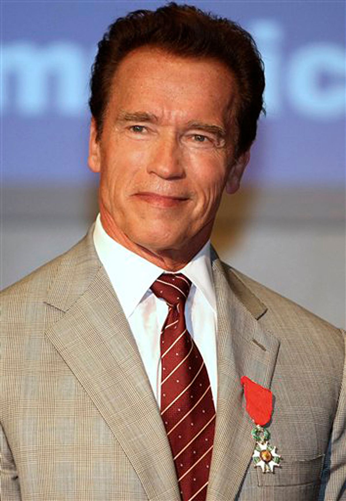 """Austrian-American, actor and former California Governor Arnold Schwarzenegger, poses after receiving the insignia of Chevalier in the Order of the Legion of Honor  during the MIPTV (International Television Programme Market), Monday, April 4, 2011, in Cannes, southern France. Arnold Schwarzenegger is back in Cannes for the first time in eight years to unveil a new international television series """"The Governator"""". (AP Photo/Lionel Cironneau) (Lionel Cironneau)"""