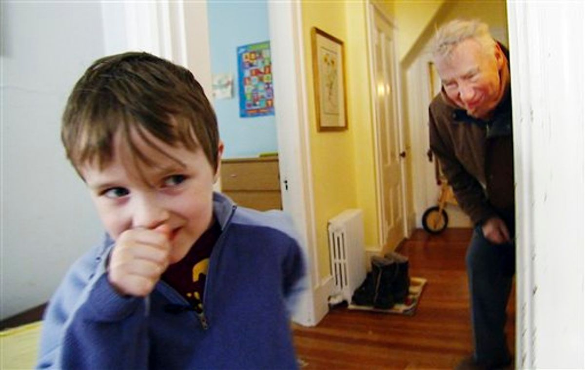 In this January 2011 still photo taken from video, PBS newsman Robert MacNeil, right, interacts with Nick, his 6-year-old grandson, at Nick's family's home in Cambridge, Mass.  After a decade off the air, MacNeil returns  Monday, April 18, 2011, with a six-part series he reported on autism, inspired by Nick, who is featured in the series. (AP Photo/PBS NewsHour)   (AP)