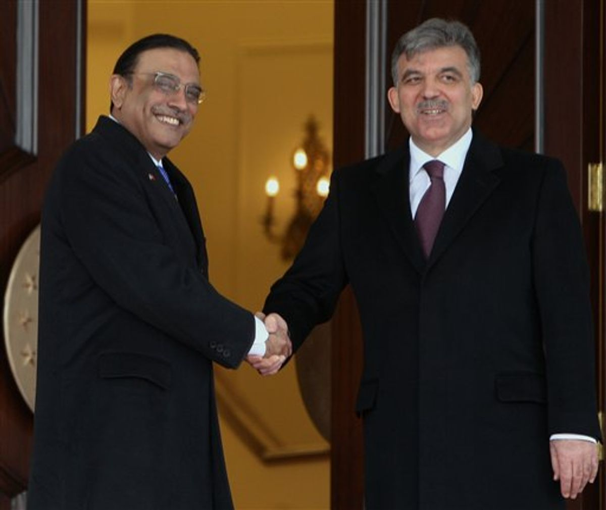 Pakistan's President Asif Ali Zardari, left, and his Turkish counterpart Abdullah Gul shake hands as they pose for cameras during a ceremony at the Cankaya presidential palace in Ankara, Turkey, Wednesday, April 13, 2011. Zardari is in Turkey for a four-day state visit.(AP Photo/Burhan Ozbilici) (AP)