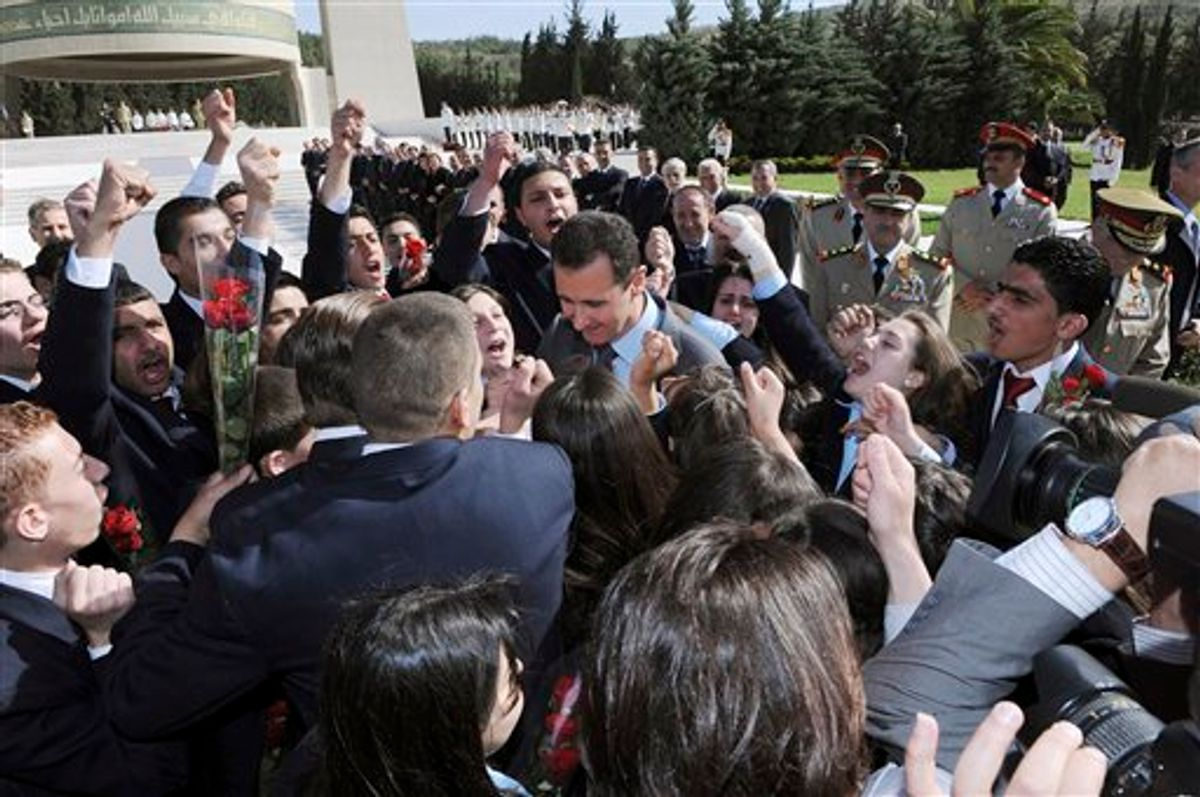 In this photo released by the Syrian official news agency SANA, Syrian students shout supportive slogans to Syrian President Bashar Assad, center, as he arrives to lay a wreath at the tomb of the unknown soldier during Martyrs day in Kasiyoun mountain in Damascus, Syria, Friday, May 6, 2011. Syrian activists say security forces are taking strict measures around the country as anti-regime protesters prepare for a new day of demonstrations. (AP Photo/SANA) EDITORIAL USE ONLY  (AP)