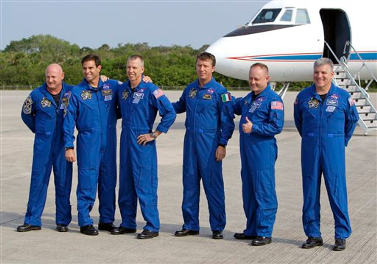 The astronauts of space shuttle Endeavour, from left, commander Mark Kelly, Canadian born U.S. astronaut Greg Chamitoff, mission specialist Drew Feustel, European Space Agency astronaut Roberto Vittori, of Italy, mission specialist Mike Fincke and British born U.S. astronaut, pilot Greg Johnson, gather for a photo after arriving at the Kennedy Space Center in Cape Canaveral, Fla., Thursday, May 12, 2011. The astronauts for NASA's next-to-last space shuttle flight returned to Florida on Thursday for another try at launching to the International Space Station. (AP Photo/John Raoux) (AP)