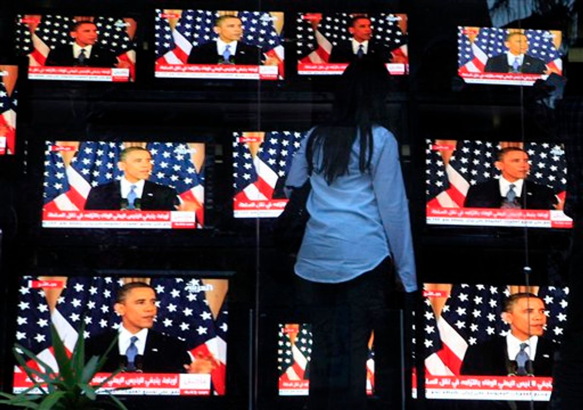 """An Egyptian woman watches U.S. President Barack Obama's policy address, outside a shop selling televisions in Cairo, Egypt Thursday, May 19, 2011. President Barack Obama on Thursday endorsed a key Palestinian demand for the borders of its future state and prodded Israel to accept that it can never have a truly peaceful nation based on """"permanent occupation."""" (AP Photo/Amr Nabil) (AP)"""