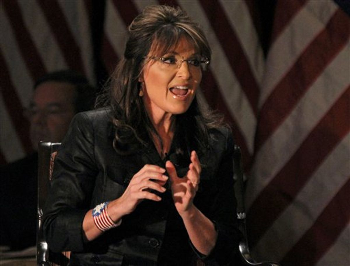 FILE - In a Feb. 17, 2011 file photo, former Alaska Governor Sarah Palin answers questions at the public appearance at Long Island (LIA) Association Meeting and Luncheon in Woodbury, N.Y. Palin will share the stage in Colorado Monday, May 2, 2011 at a fundraiser at Colorado Christian University with Retired Lt. Gen. William Boykin, a former senior military intelligence official who disparaged Islam while helping to lead the war on terror after Sept. 11. Monday evening's speech was already scheduled before Sunday's killing of Osama bin Laden.  (AP Photo/Craig Ruttle, File) (AP)