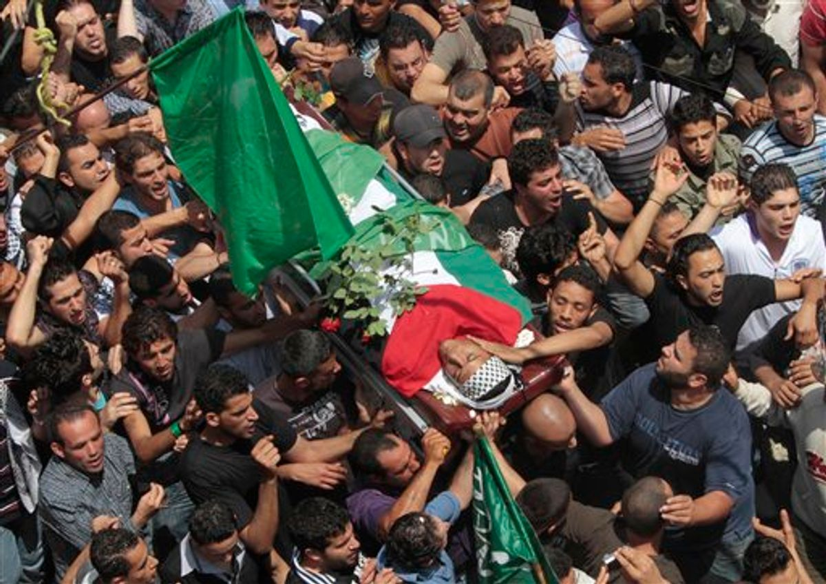 Palestinian mourners carry the body of a Palestinian man who killed when Israeli soldiers opened fire on Sunday at protesters who approached the northen Israeli border with Lebanon, during a funeral procession at Ein el-Hilweh Palestinian refugee camp, in the southern port city of Sidon, southern Lebanon, on Monday May 16, 2011. Israeli troops clashed with Arab protesters along three hostile borders on Sunday, leaving as many as 12 people dead and dozens wounded in an unprecedented wave of violence marking the anniversary of the mass displacement of Palestinians surrounding Israel's establishment in 1948. (AP Photo/Mohammed Zaatari) (AP)