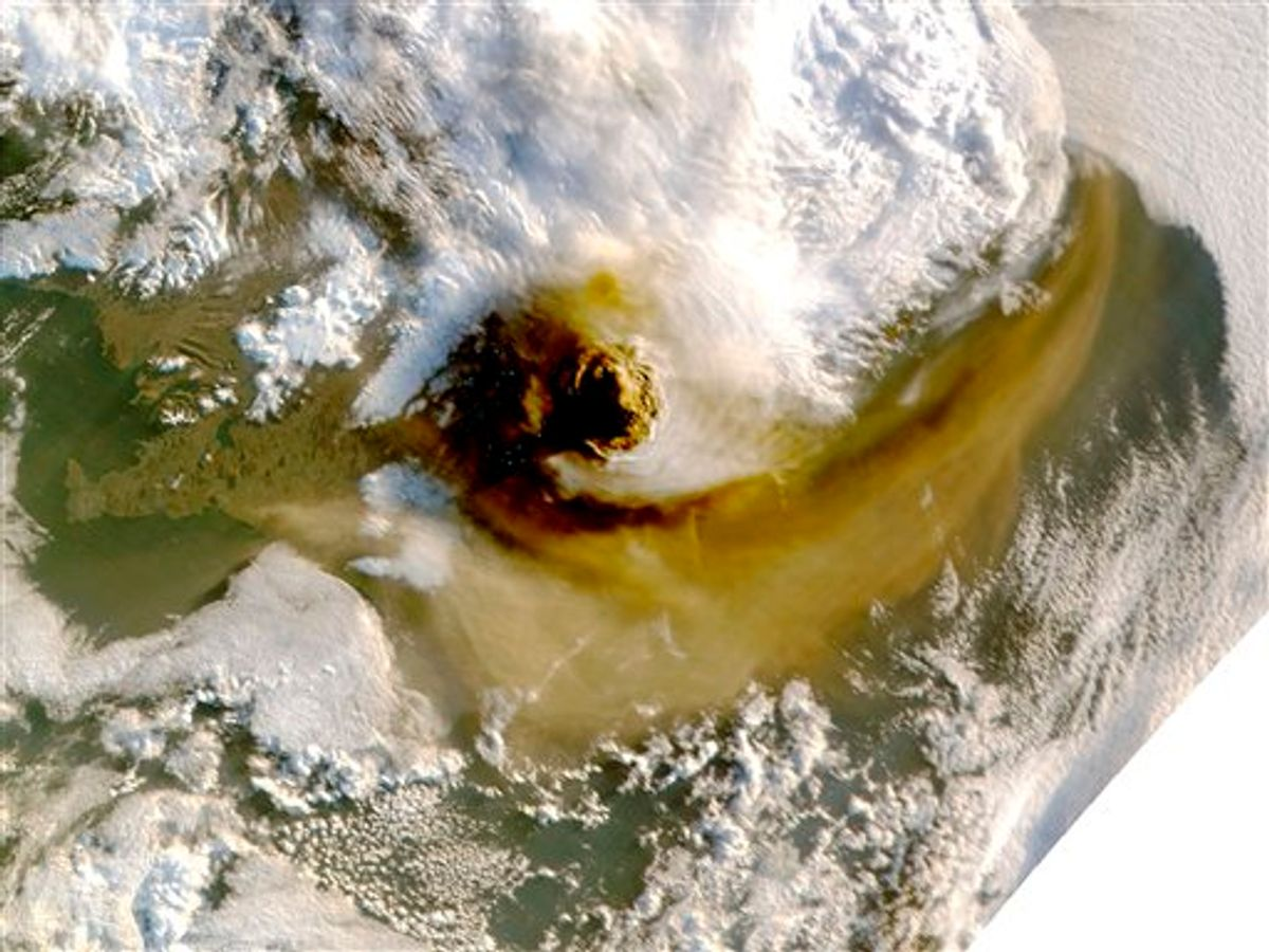 This image provided by NASA shows an image taken by a NASA MODIS satellite acquired at 1:15 a.m. EDT  on May 22, 2011 shows the ash plume from the Grimsvotn volcano casts shadow to the west. The Grimsvotn volcano began erupting on Saturday, May 21 sending clouds of ash high into the air. The amount of ash spewing from the volcano tapered off dramatically on Tuesday, however, said Elin Jonasdottir, a forecaster at Iceland's meteorological office.  The blue dots are data dropouts probably caused by the very bad light in the shadow of the plume. (AP Photo/NASA) (AP)