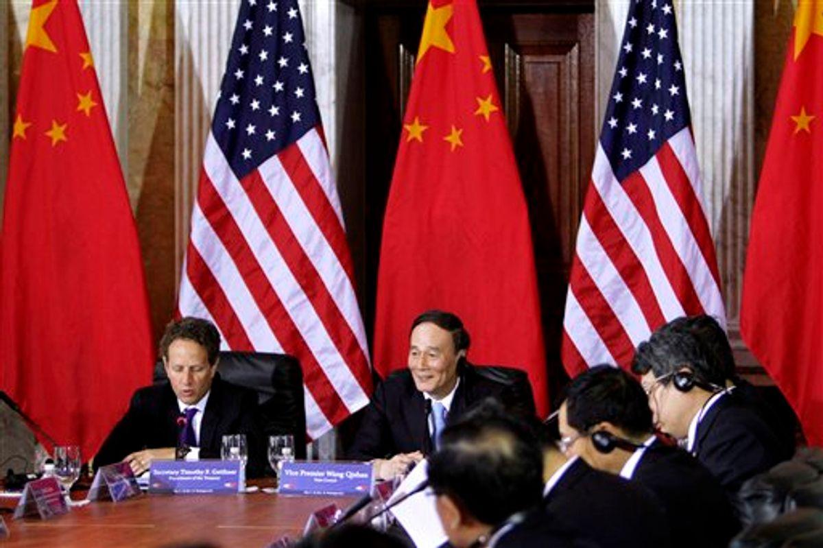 Treasury Secretary Timothy Geithner meets with China's Vice Premier Wang Qishan, center, during the US-China Strategic and Economic Dialogue meetings, Monday, May 9, 2011, at the Treasury Department in Washington. (AP Photo/Jacquelyn Martin)  (AP)