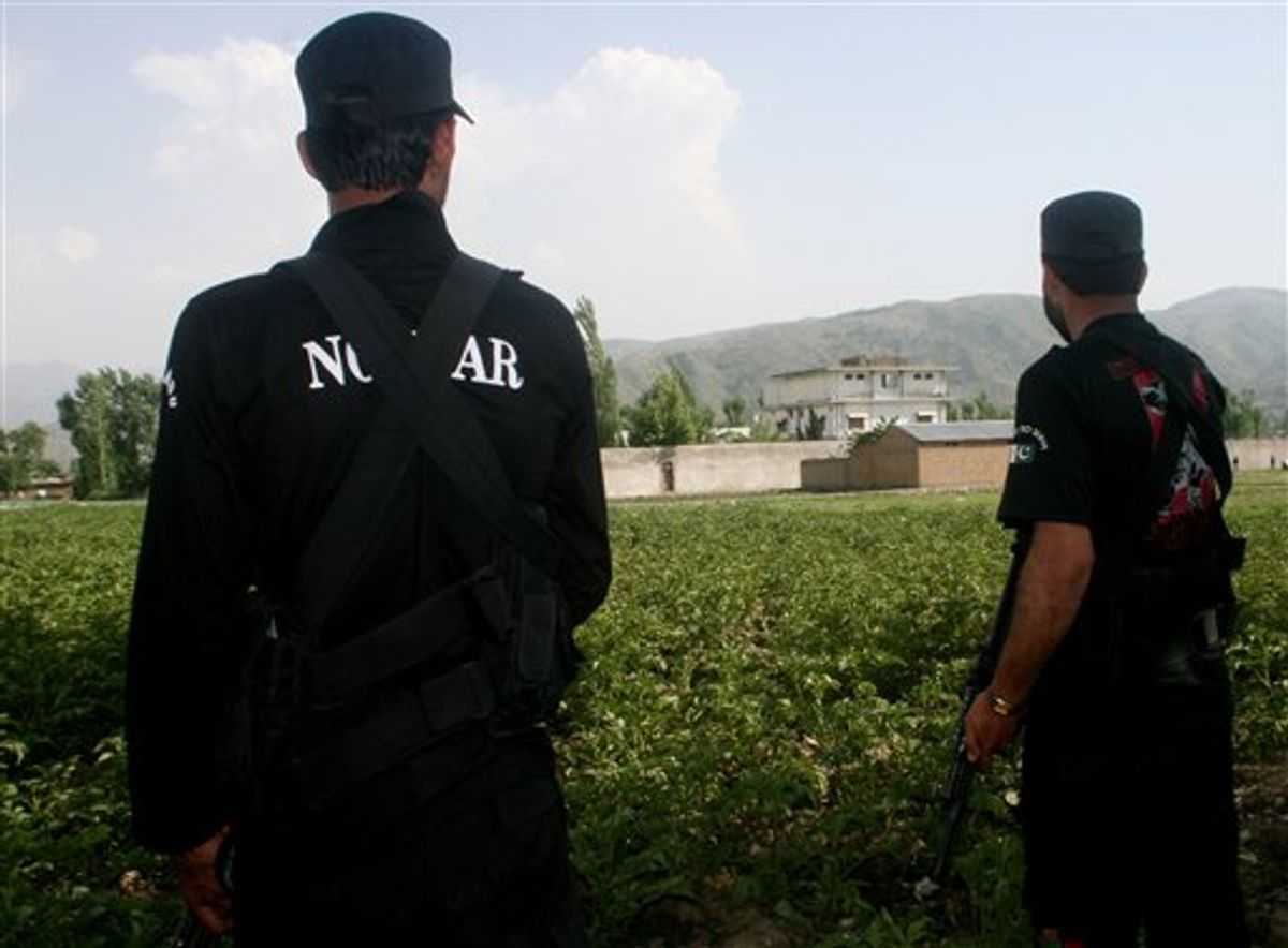Pakistani security officers stand guard near the perimeter of the compound of al-Qaida leader Osama bin Laden in Abbottabad, Pakistan, Wednesday, May 4, 2011.  Many of the residents of Abbottabad seem to be confused and suspicious about the killing of Osama bin Laden, which took place in their midst before dawn on Monday, even as the U.S. White House has struggled to communicate its account of the audacious raid that killed Osama bin Laden for both a jubilant American public and a skeptical Muslim world. (AP Photo/Aqeel Ahmed) (AP)