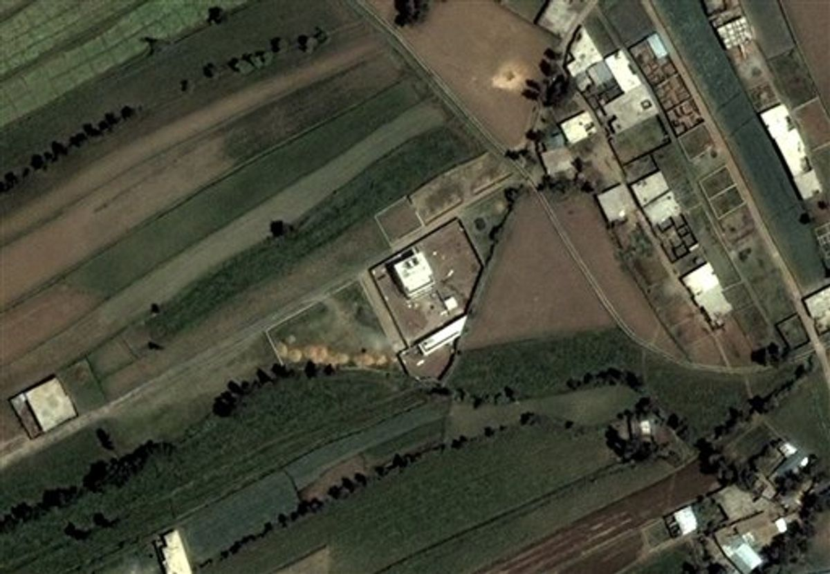 This June 15, 2005 satellite image provided by DigitalGlobe shows the compound, center, in Abbottabad, Pakistan, where Osama bin Laden lived. Bin Laden, the face of global terrorism and mastermind of the Sept. 11, 2001, attacks, was tracked down and shot to death at the compound by an elite team of U.S. forces on Monday, May 2, 2011, ending an unrelenting manhunt that spanned a frustrating decade. (AP Photo/DigitalGlobe) (AP)