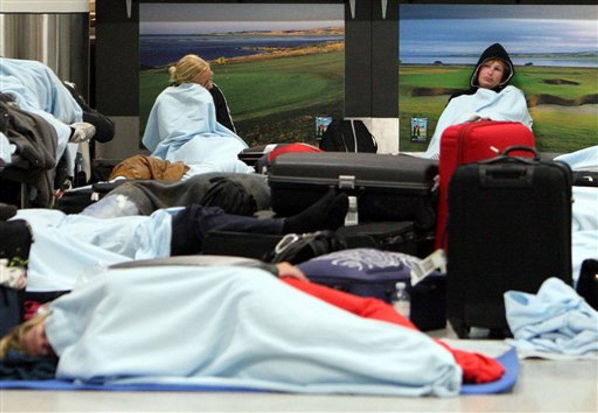 Passengers rest on the floor as their flights have been canceled at Edinburgh Airport in Edinburgh, Scotland Tuesday, May 24, 2011. A dense ash cloud from an Icelandic volcano blew toward Scotland, causing airlines to cancel Tuesday flights and raising fears of a repeat of last year's huge travel disruptions in Europe that stranded millions of passengers. (AP Photo/Scott Heppell) (AP)