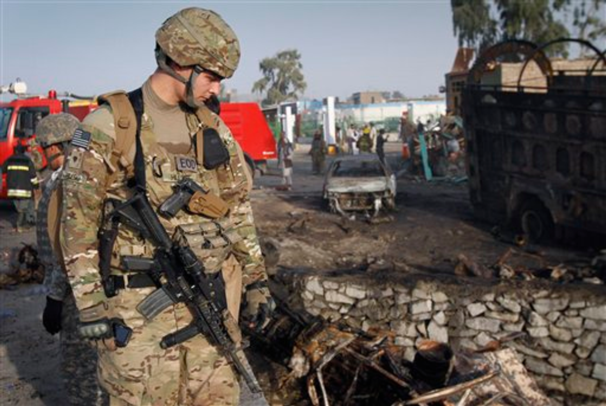 An unidentified U.S. soldier is seen at the scene of a suicide attack in Jalalabad, Afghanistan on Wednesday, May 18, 2011