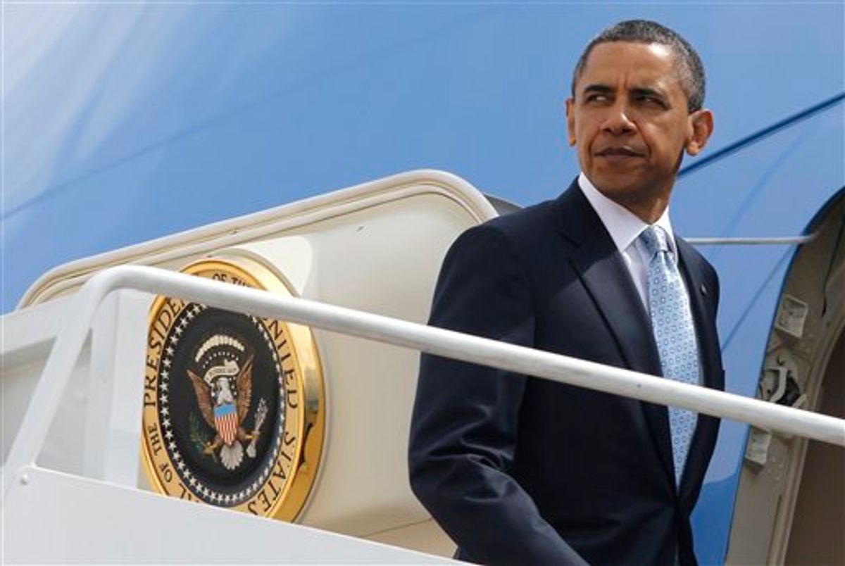 President Barack Obama boards Air Force One at Andrews Air Force Base, Md., Tuesday, May 10, 2011, as he travels to the U.S.-Mexico border at El Paso, Texas, to speak about immigration reform, Tuesday, May 10, 2011. (AP Photo/Charles Dharapak) (AP)