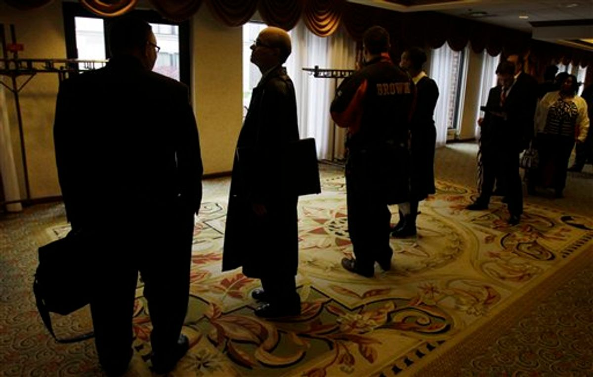 In this May 3, 2011 photo, job seekers wait in line for a job fair to open, in Independence, Ohio. The number of Americans applying for unemployment benefits surged last week to the highest level in eight months, a sign the job market may be weakening.(AP Photo/Tony Dejak) (AP)