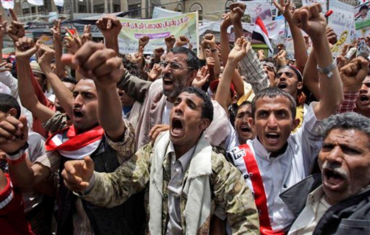Anti-government protestors, shout slogans during a demonstration demanding the resignation of Yemeni President Ali Abdullah Saleh, in Sanaa, Yemen, Monday, May 23, 2011.   (AP Photo/Hani Mohammed) (AP)