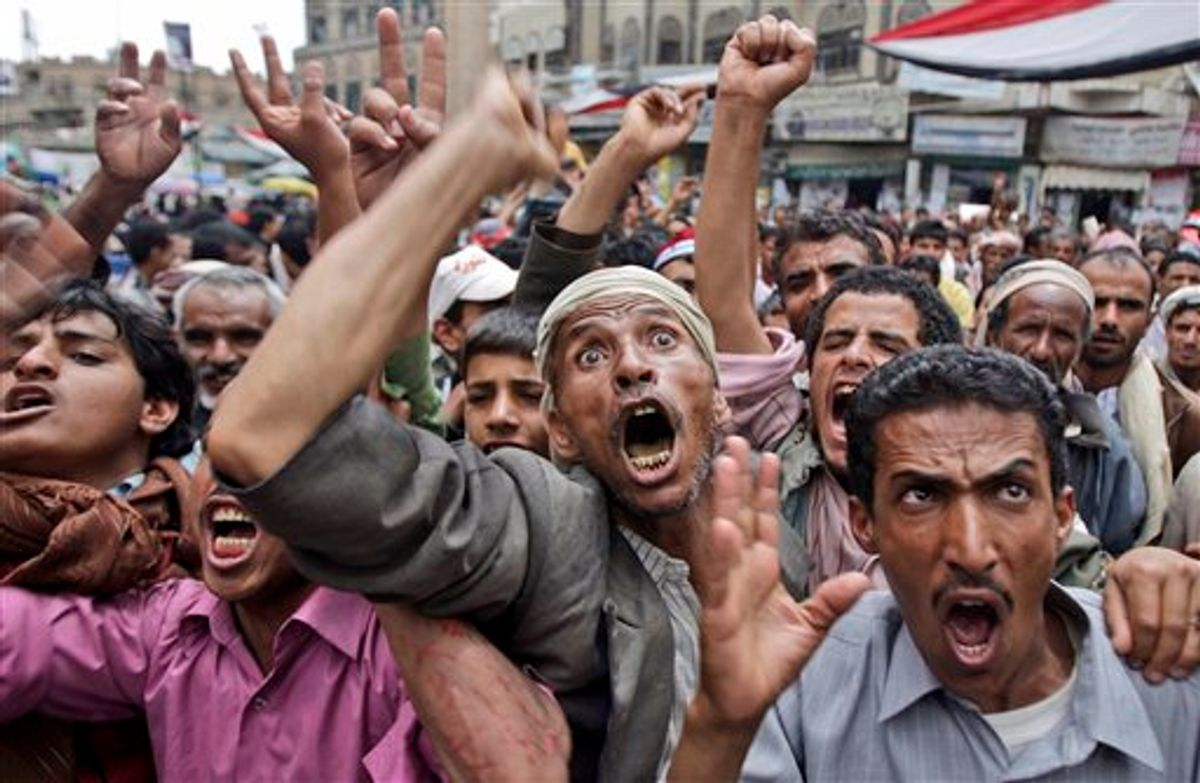 Anti-government protestors react during a demonstration demanding the resignation of Yemeni President Ali Abdullah Saleh, in Sanaa,Yemen, Thursday, May 5, 2011. Yemen, which is currently wracked by the popular protests against the country's deeply unpopular president, is also home to one of the most active branches of al-Qaida, which has planned several attacks against the U.S. (AP Photo/Hani Mohammed) (AP)
