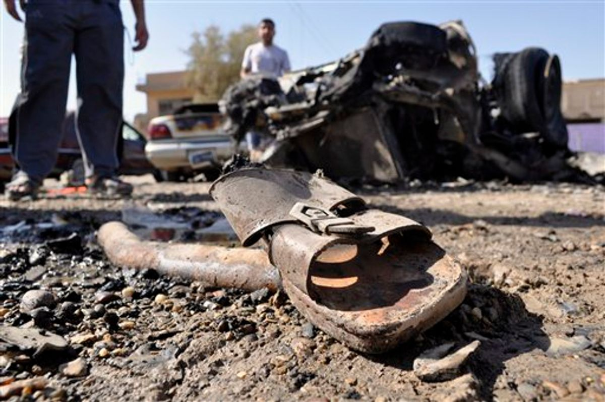 A discarded sandal is seen amid debris and destroyed vehicles the morning after four blasts killed several people in Ramadi, 70 miles (115 kilometers) west of Baghdad, Iraq, Friday, June 3, 2011. The blasts in what was the heartland of the al-Qaida-led insurgency are a reminder of the danger still facing Iraq, as it prepares for the departure of the remaining U.S. troops by the end of this year.(AP Photo) (AP)