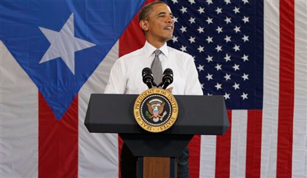 President Barack Obama speaks in an airport hanger at Muniz Air National Guard Base, Tuesday, June 14, 2011, in San Juan, Puerto Rico. (AP Photo/Carolyn Kaster) (AP)
