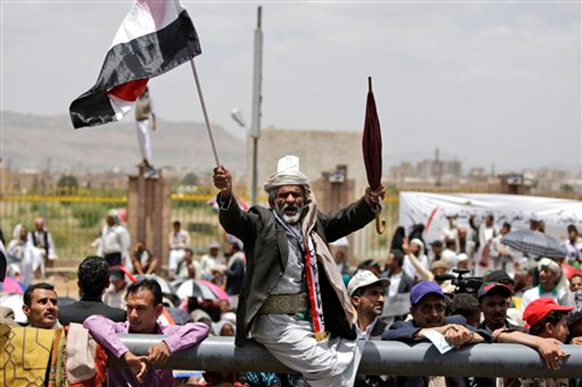 An anti-government protestor, reacts during a demonstration demanding the resignation of Yemeni President Ali Abdullah Saleh, in Sanaa, Yemen, Friday, June 3, 2011. A government official says Yemen's president was lightly injured and four top officials wounded when opposition tribesmen struck his palace with rockets Friday. (AP Photo/Hani Mohammed) (AP)