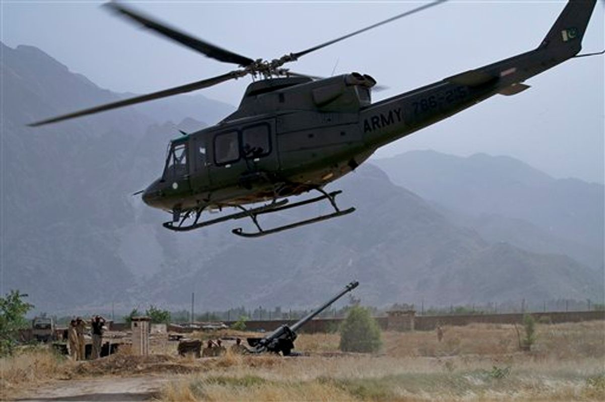 A Pakistan army helicopter take off as troops wait for clearance to use heavy artillery towards alleged militants hideouts in the mountain ranges in Mamad Gat, in Pakistan's Mohmand tribal region along the Afghan border, Wednesday, June 1, 2011. A top Pakistani army commander said that the military has no imminent plans to launch an offensive in the North Waziristan tribal region, home to numerous militants who focus on attacking U.S. and NATO forces in neighboring Afghanistan. (AP Photo/Anjum Naveed) (AP)