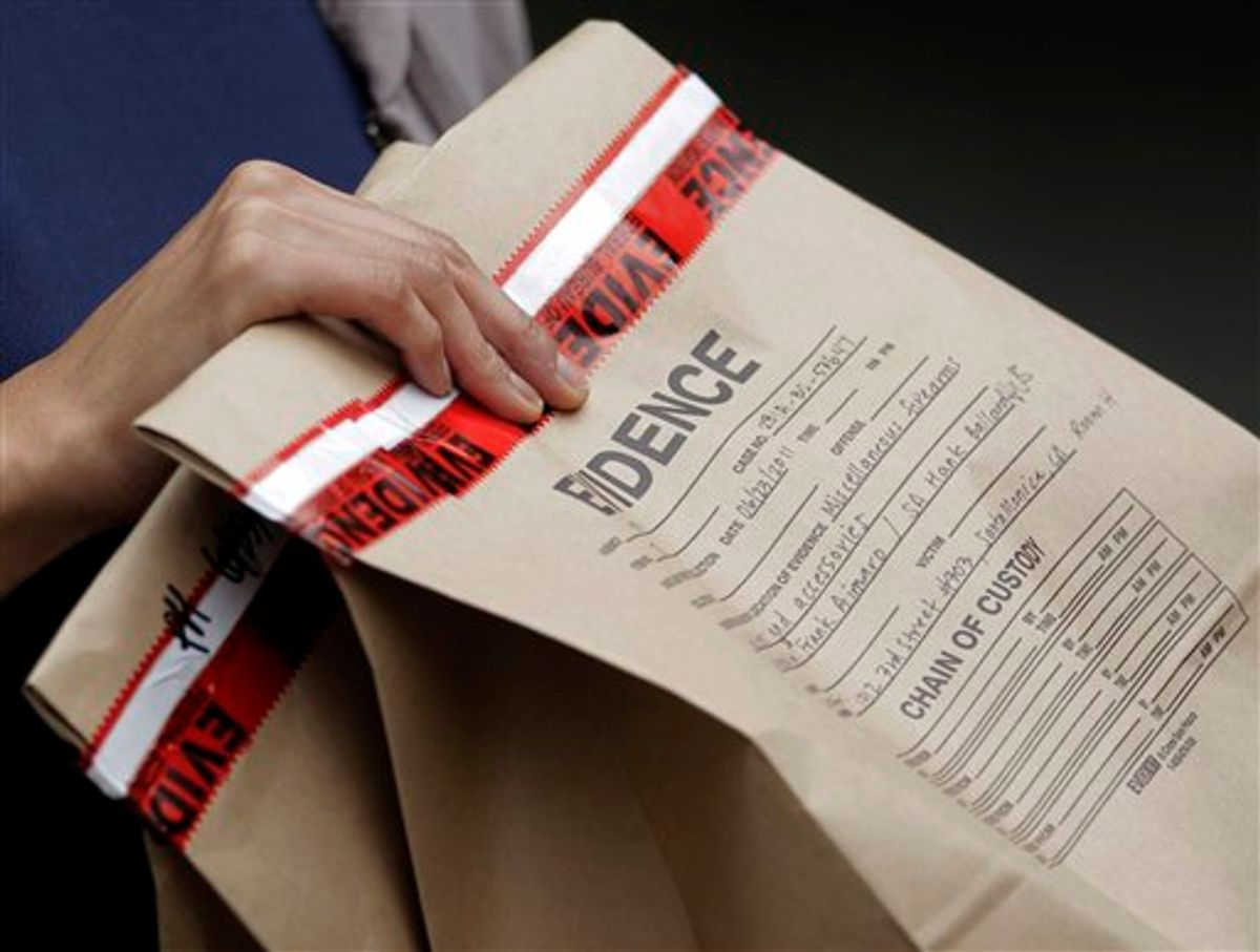"""An FBI agent holds an evidence bag outside an apartment complex where fugitive crime boss James """"Whitey"""" Bulger and his longtime companion Catherine Greig were arrested in Santa Monica, Calif., Thursday, June 23, 2011. The Boston mob boss was captured near Los Angeles after 16 years on the run that embarrassed the FBI and exposed the bureau's corrupt relationship with its underworld informants. (AP Photo/Jae C. Hong)  (AP)"""