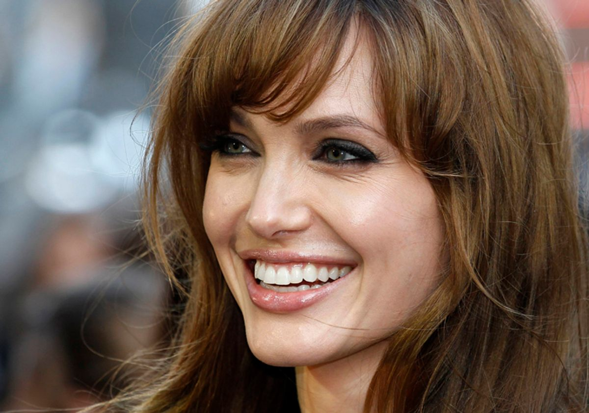 U.S. actress Angelina Jolie poses for photographers in London August 16, 2010.    (© Suzanne Plunkett / Reuters)