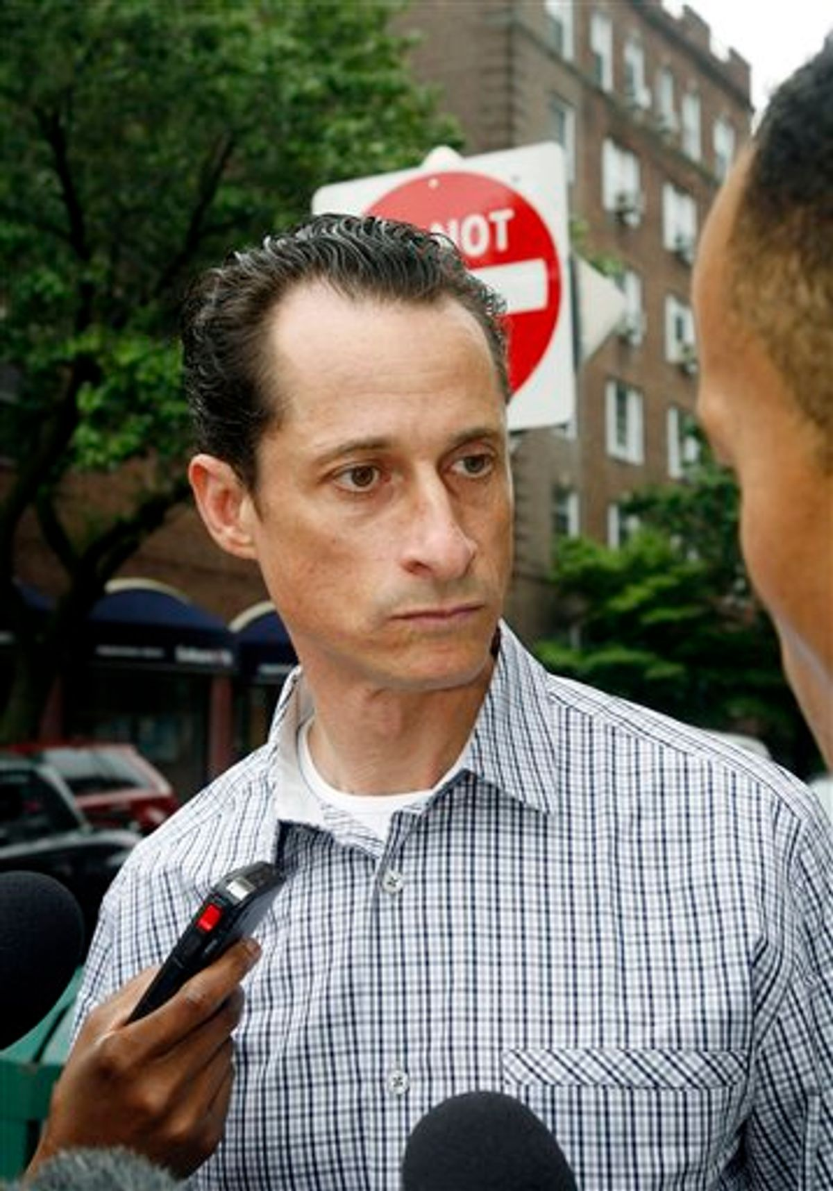 Rep. Anthony Weiner, D-N.Y., answers questions from the media as he carries his laundry to a laundromat near his home in the Queens borough of New York, Saturday, June  11, 2011. The 46-year-old congressman acknowledged Friday that he had online contact with a 17-year-old girl from Delaware but said there was nothing inappropriate. (AP Photo/David Karp) (AP)