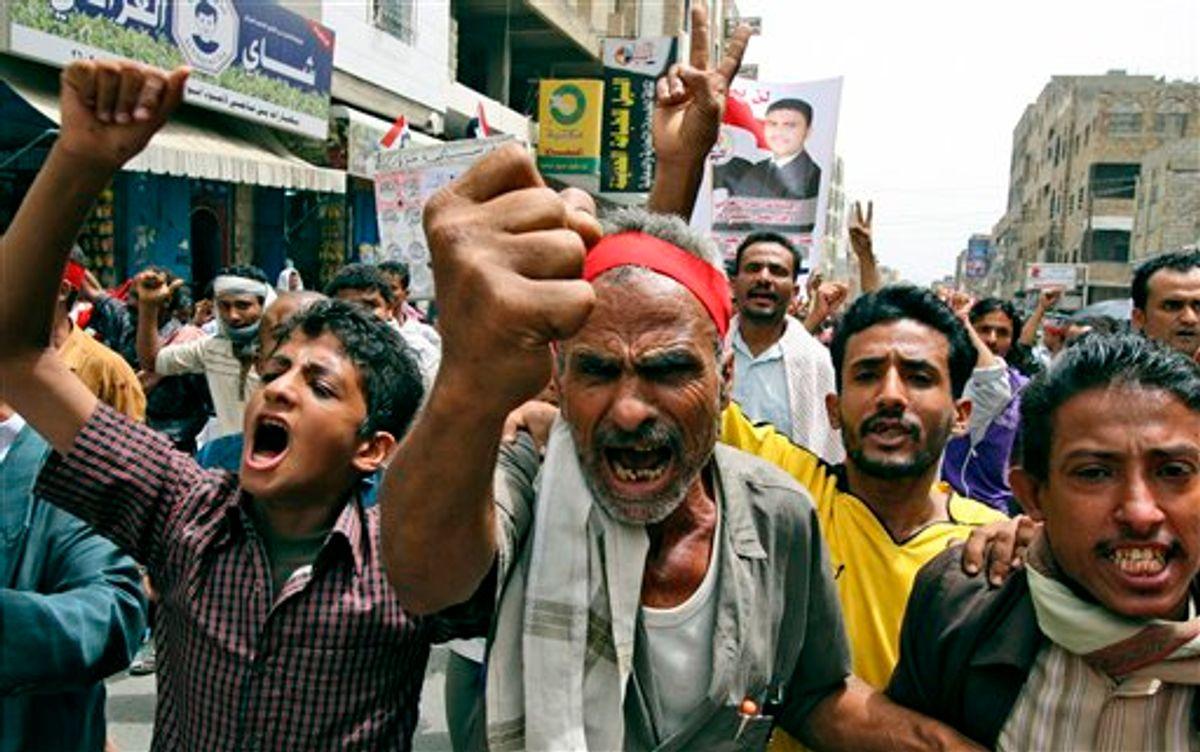 Anti-government protestors shout slogans during a demonstration demanding the resignation of Yemeni President Ali Abdullah Saleh, in Taiz, Yemen, Sunday, June 19, 2011. (AP Photo/Anees Mahyoub) (AP)