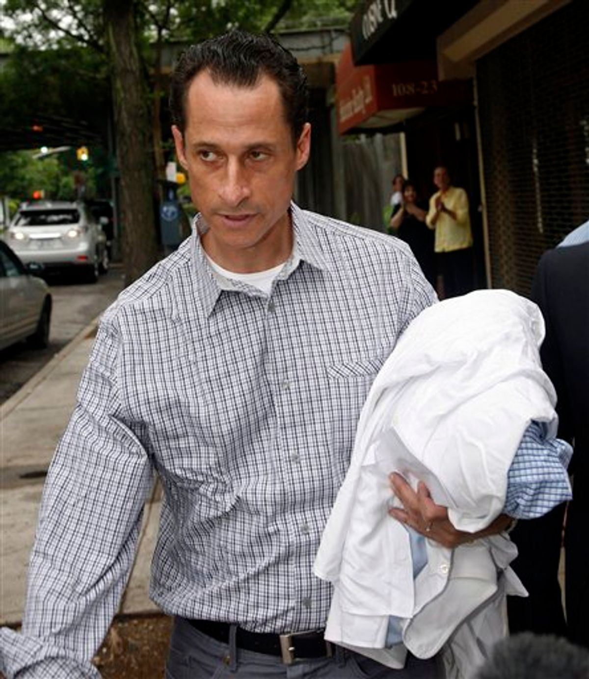 FILE - In this June 11, 2011 file photo, Rep. Anthony Weiner, D-N.Y., carries his laundry to a laundromat near his home in the Queens borough of New York, Saturday, June  11, 2011. Weiner admitted last week that he had Tweeted sexually charged messages and photos to at least six women and lied about it.  (AP Photo/David Karp, File)  (AP)