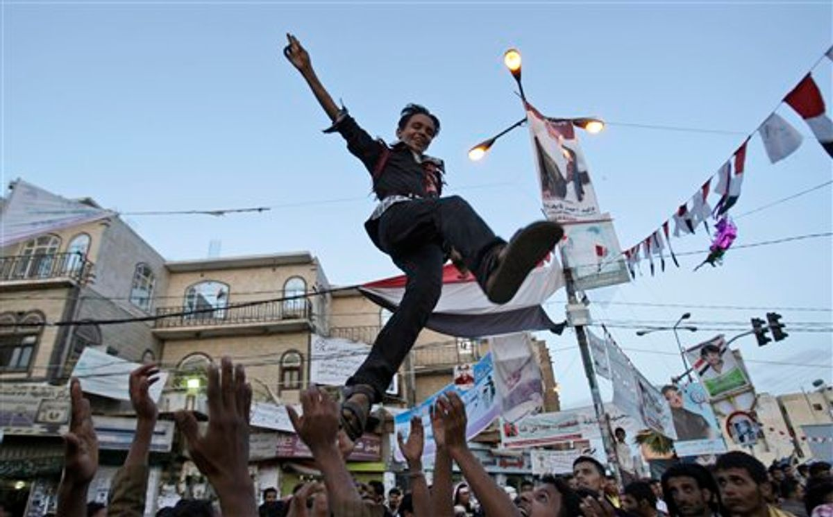 Anit-government protestors reach to catch a youth, after throwing him in to the air while celebrating President Ali Abdullah Saleh's departure to Saudi Arabia, in Sanaa, Yemen, Monday, June 6, 2011. A cease-fire in Yemen's capital was at risk of unraveling Monday as regime supporters opened fire on opposition fighters in renewed clashes that killed at least six. The violence raises fears over the potentially explosive situation after the wounded President Ali Abdullah Saleh left the country, creating a deep power vacuum. (AP Photo/Hani Mohammedi) (AP)